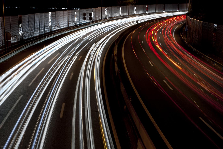 Highway-traffic-at-night-long-exposure-000037880856_Large