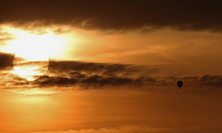 Orange sky, sun through the clouds